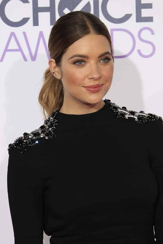 Ashley Benson attended the Peoples Choice Awards 2016 at the Microsoft Theatre L.A. Live on January 6, 2016 in Los Angeles, CA. She wore a stunning all-black dress to pair with her slick sandy blonde balayage ponytail hairstyle.