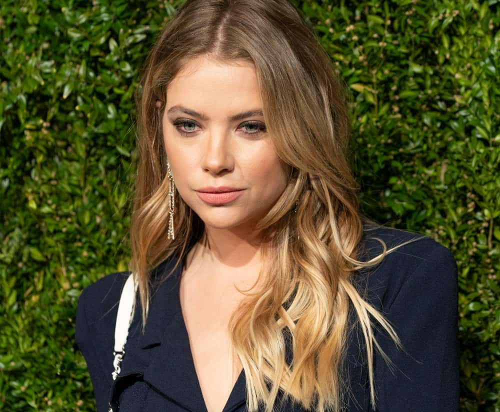 On April 29, 2019, Ashley Benson attended the Chanel 14th Annual Tribeca Film Festival Artists Dinner at Balthazar. She wore a blue smart casual outfit with her long, sandy blonde, layered and wavy loose hairstyle with highlights.