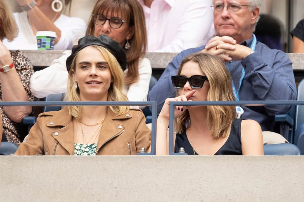 On Sep 7, 2019, Cara Delevingne and Ashley Benson attended the US Open womens final at Billie Jean King Tennis Center. Benson wore a casual blouse with her shoulder-length layered and loose blond hairstyle.