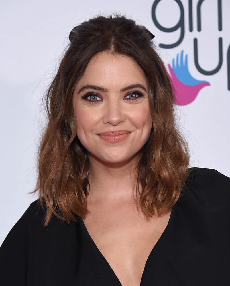 Ashley Benson attended the 2nd Annual Girl Up #GirlHero Awards on October 13, 2019 in Beverly Hills, CA. She dyed her blond hair into a highlighted dark brown tone and styled it into a shoulder-length loose and wavy half-up hairstyle.