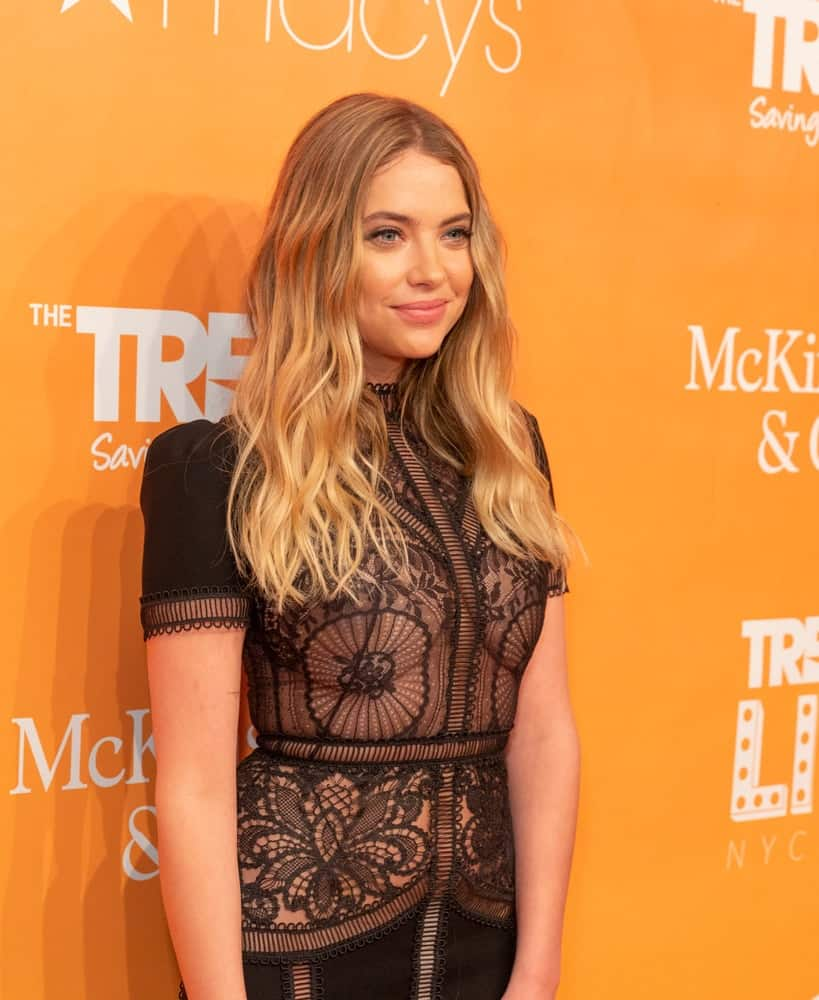 On June 17, 2019, Ashley Benson attended the 2019 Trevor LIVE New York Gala for The Trevor Project at Cipriani Wall Street. She wore a detailed black dress that she paired with her balayage long sandy blonde hairstyle with beach waves.