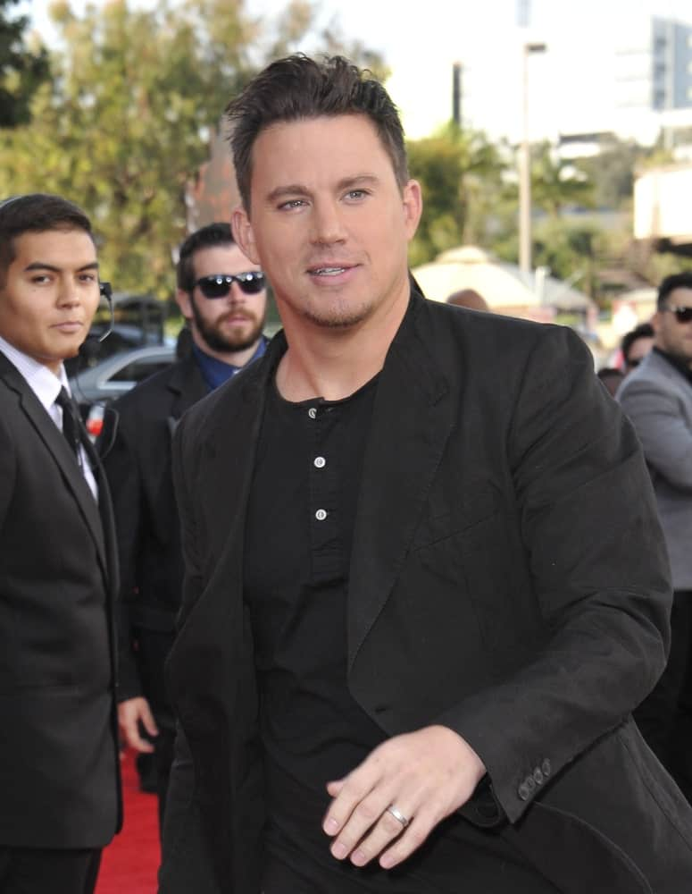 Channing Tatum rocked a messy pompadour hairstyle complemented with an all black top during the 2014 MTV Movie Awards at the Nokia Theatre LA Live on April 13, 2014.