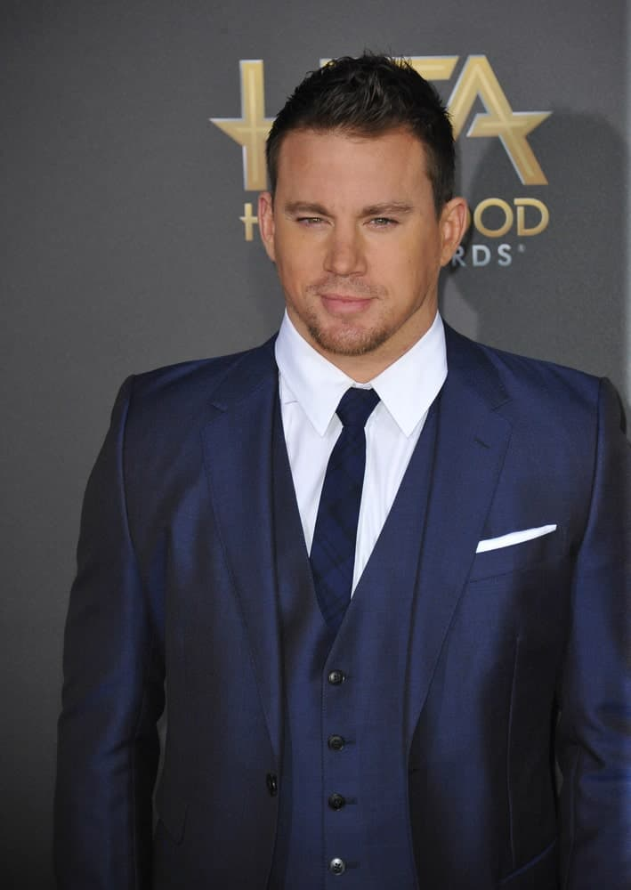 The actor arrived at the 2014 Hollywood Film Awards on November 14th in a sleek navy blue suit paired with his short brushed up hairstyle.