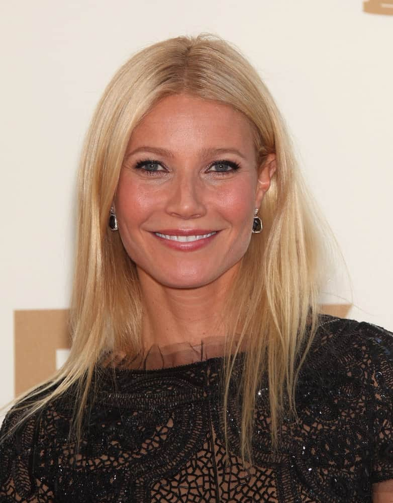 Gwyneth Paltrow rocked a slightly messy hairstyle paired with a black lace dress at the Emmy Awards 2011 held on August 11, 2012 in Los Angeles, CA.
