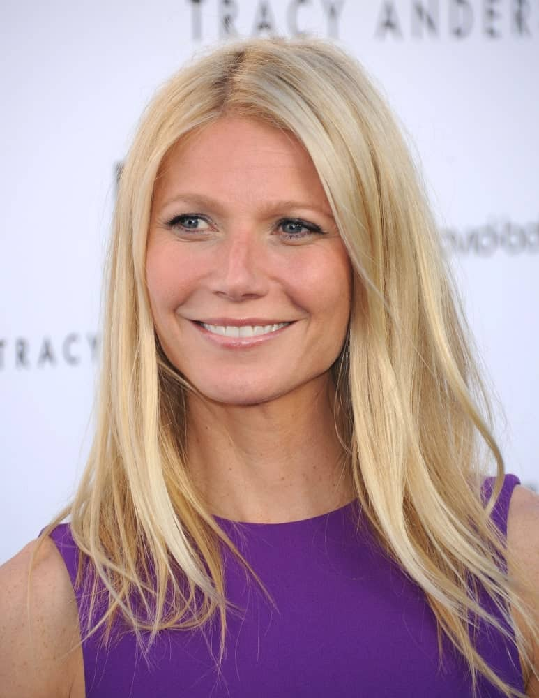 Gwyneth Paltrow was seen at the Tracy Anderson Flagship Studio Opening on April 04, 2013 in a bold purple dress and a slightly tousled hairstyle with middle parting.