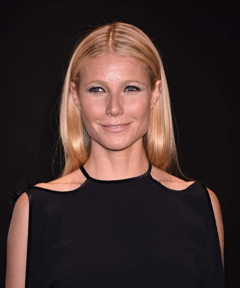 Gwyneth Paltrow complemented her cold shoulder dress with a sleek center-parted hairstyle in straight blonde at the Tom Ford Autumn/Winter 2015 Womenswear Collection Presentation held on February 20th.