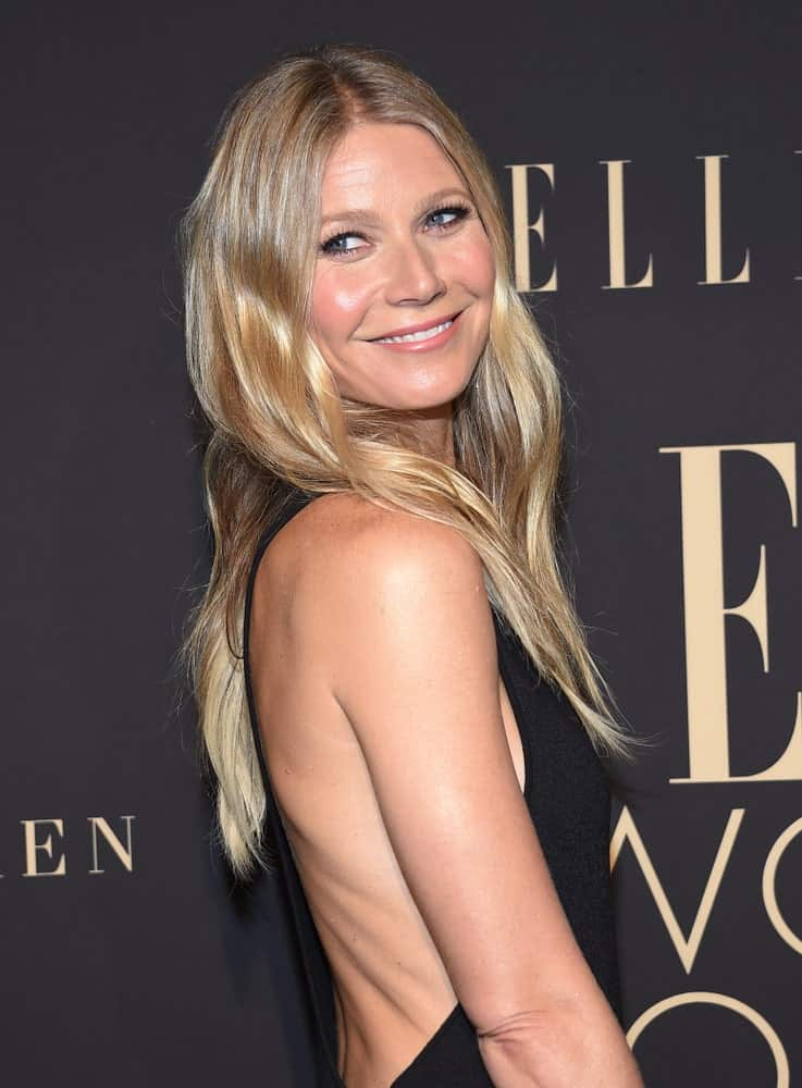 Gwyneth Paltrow looked gorgeous in a black dress and her long blonde locks styled in a simple loose hairstyle. This look was worn at the ELLE Women in Hollywood on October 14, 2019.