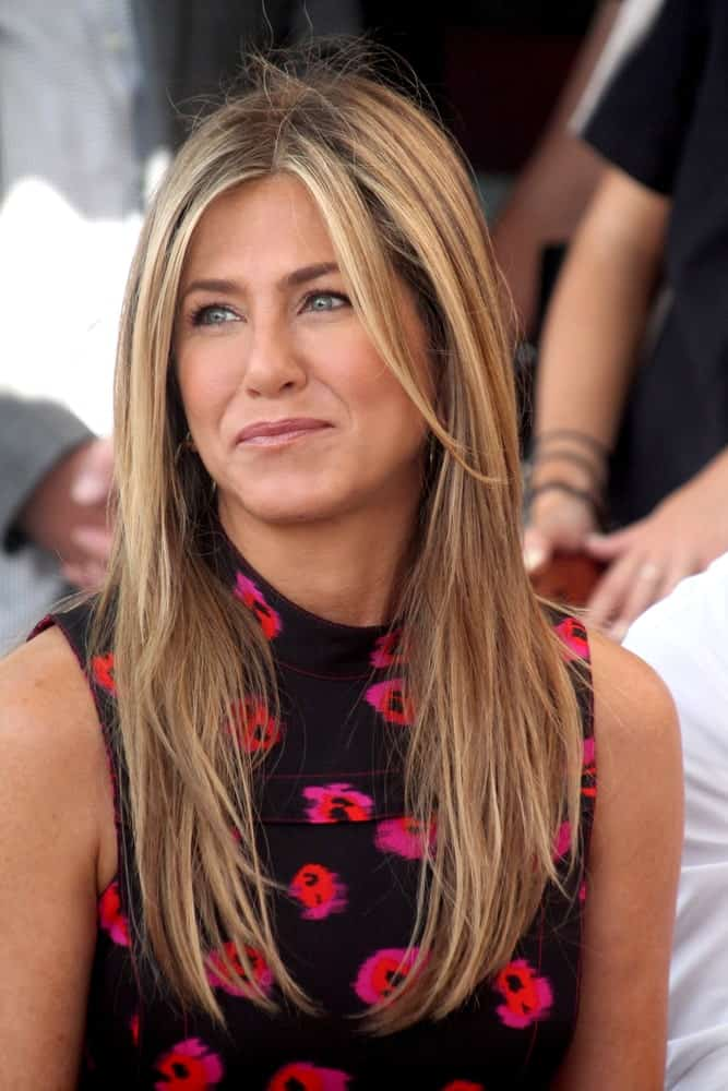 Jeniffer Aniston made an appearance at the Jason Bateman Hollywood Walk of Fame Star Ceremony at the Walk of Fame on July 26, 2017. She wore a gorgeous floral dress that perfectly goes with her long blonde tresses.