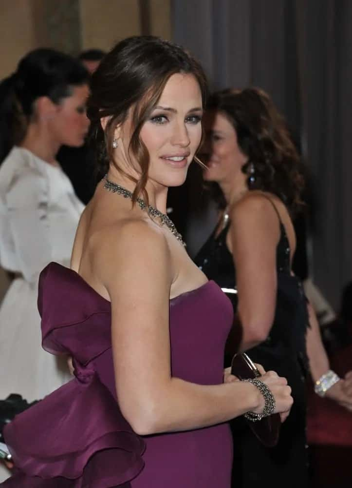 The American actress wore her up-styled brunette tresses with curled long-side bangs to frame her face at the 85th Academy Awards on February 24, 2013.