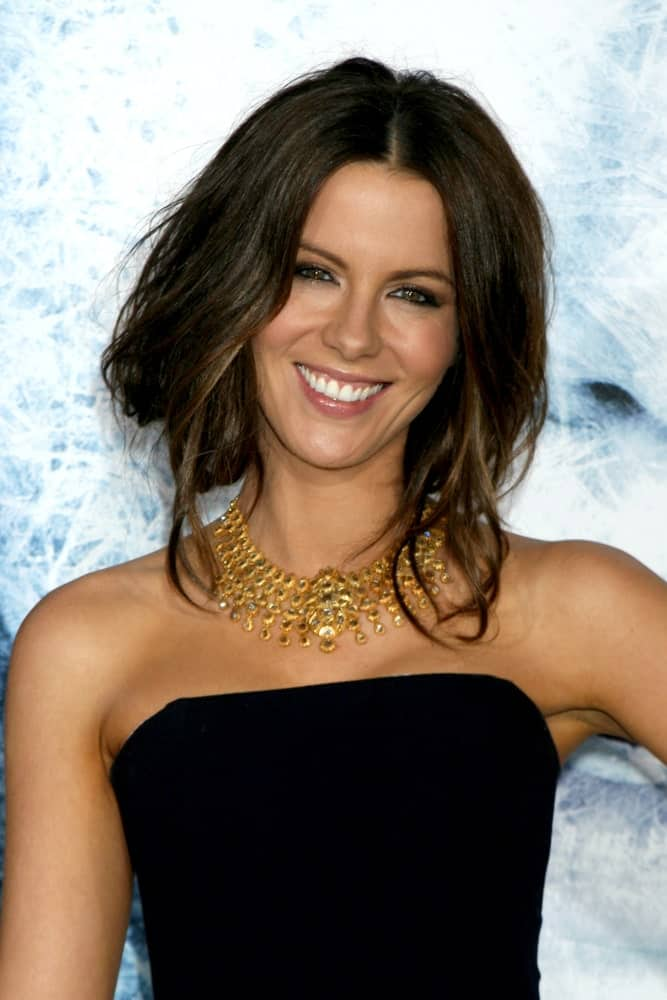 Kate Beckinsale gathered her thick, straight locks into a loose half upstyle during the