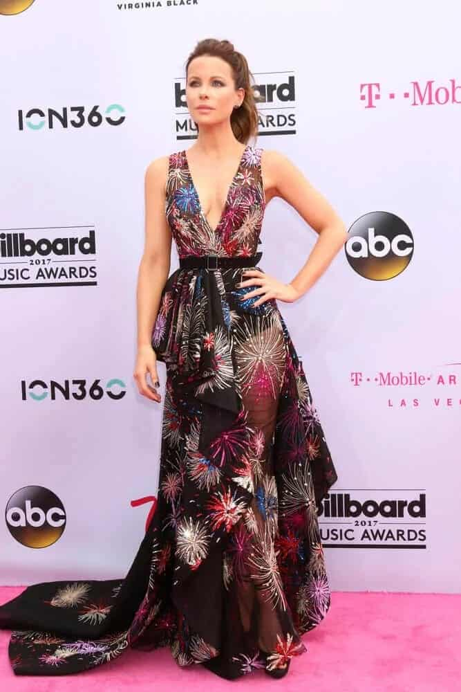 Kate Beckinsale matched her uniquely designed long dress with a simple and casual ponytail to balance out the overall finish. This look was worn for the 2017 Billboard Music Awards held at the T-Mobile Arena, Las Vegas, NV.