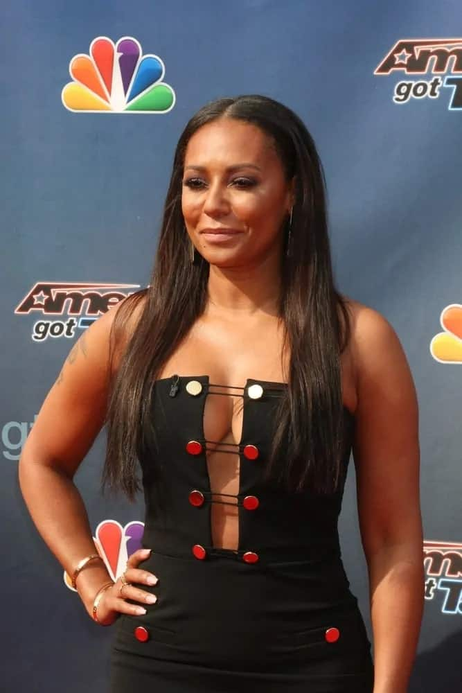 Mel B highlighted her slender physique in a black dress with a cleavage-showing front cutout and had her long straight dark hair down to complete her eye-catching look at the America's Got Talent Judges Photocall on March 3, 2016.