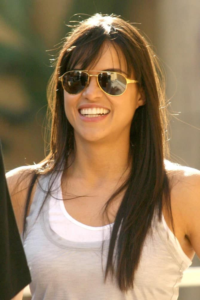 Michelle Rodriguez opted for a casual look with a tank top and loose hairstyle at the induction ceremony for James Cameron into the Hollywood Walk of Fame on December 18, 2009.