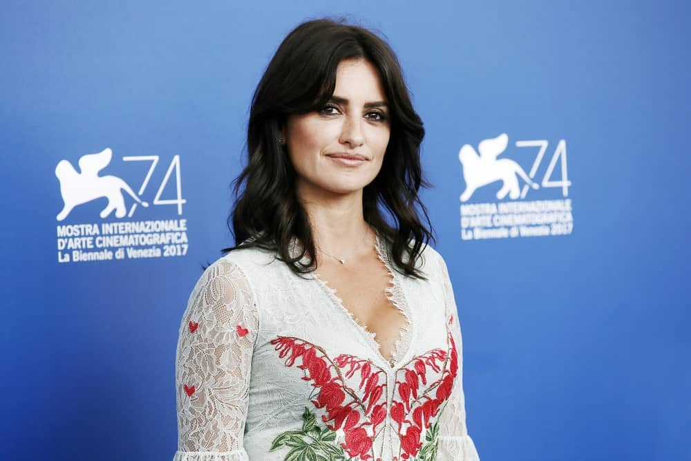 On September 6, 2017, Penelope Cruz attended the photo-call of the movie 'Loving Pablo' wearing a white lace dress and beach waves hairstyle.