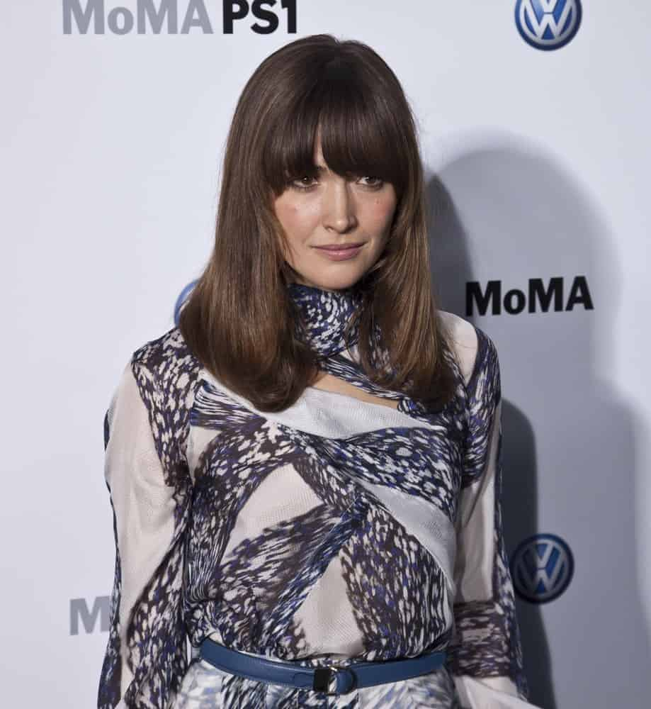 Rose Byrne attended the MoMA launch of the partnership between Volkswagen and the Museum of Modern Art on May 23, 2011, in New York City. She wore a fashionable dress with her long and straight dark brunette hairstyle with long eye-skimmer bangs.