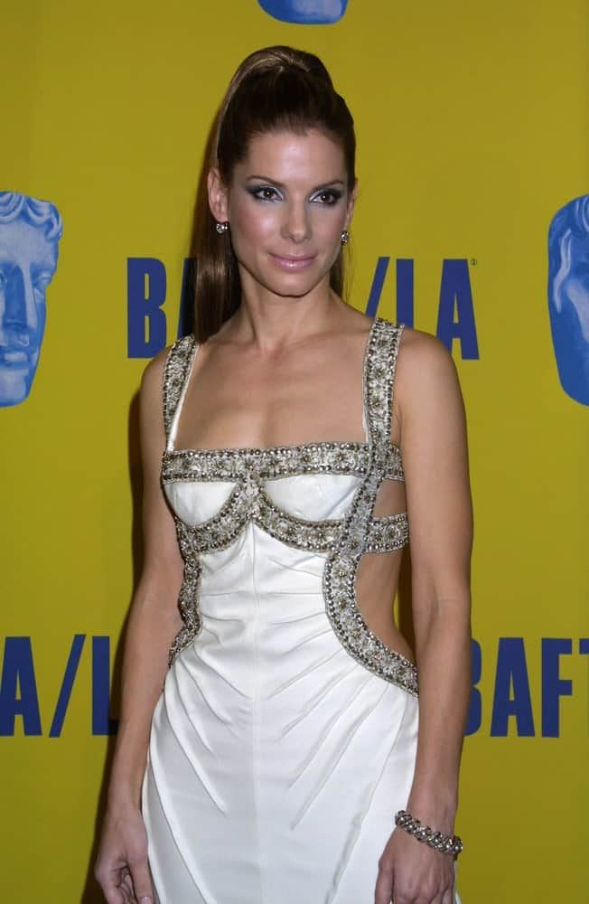 The actress Sandra Bullock attended the 2003 BAFTA/LA Britannia Awards in Los Angeles back in November 8, 2003. Her secy dress went amazingly great with her slick high ponytail hairstyle.
