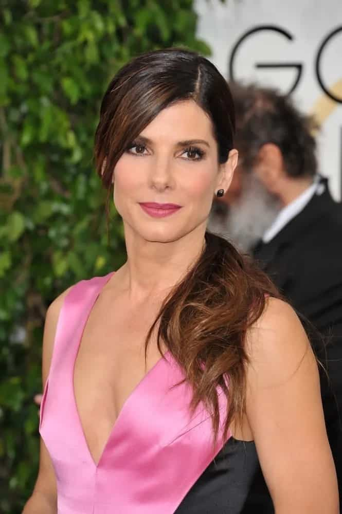 Actress Sandra Bullock went for a a simple yet sweet look with her side-swept ponytail with long side-swept bangs at the 71st Annual Golden Globe Awards back in January 12, 2014.
