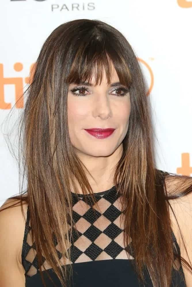 Sandra Bullock looked absolutely stunning with her loose straight hair that has blunt bangs at the 2015 'Demolition' premiere and opening night gala back in September 10, 2015.