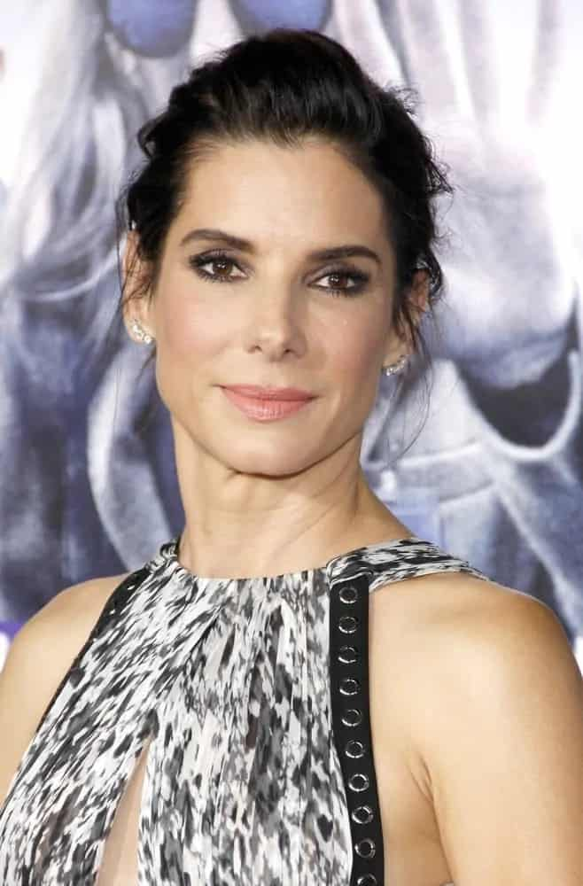 Sandra Bullock swept her raven hair up into a messy but classy upstyle with tendrils at the Los Angeles premiere of 'Our Brand Is Crisis' on October 26, 2015.
