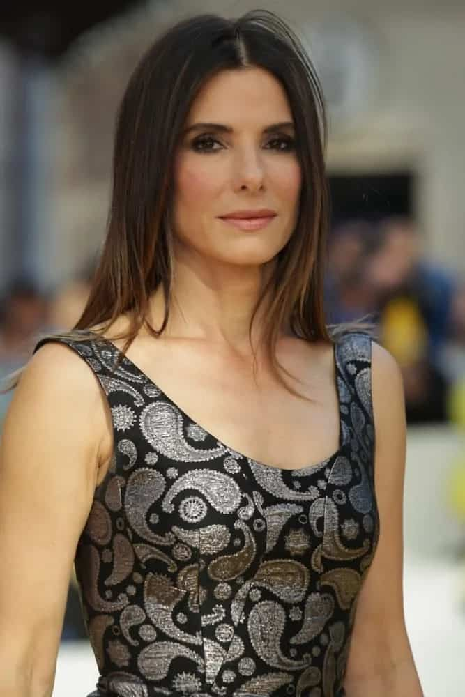 Sandra Bullock looked gorgeous with her simple straight layered hairstyle when she attended the Minions - World premiere back in June 11, 2015.