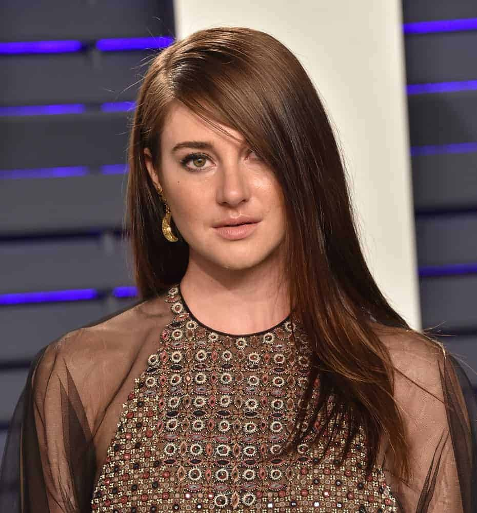 Shailene Woodley attended the Vanity Fair Oscar Party on February 24, 2019, in Beverly Hills, CA. She was seen wearing a stunning sheer dress with her long and straight brunette hairstyle with long side-swept bangs.
