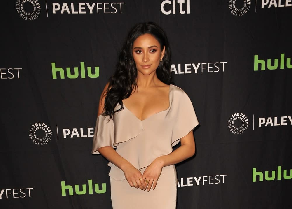 """With her raven mane styled into loose curls and tucked behind one ear at the 34th Annual PaleyFest Los Angeles - """"Pretty Little Liars"""" on March 25, 2017."""