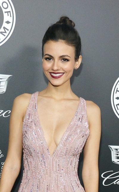 Victoria Justice was at the Art Of Elysium's 11th Annual Heaven Celebration held at the Barker Hangar in Santa Monica on January 6, 2018. She came in a stunning gown to pair with her slick high bun hairstyle.