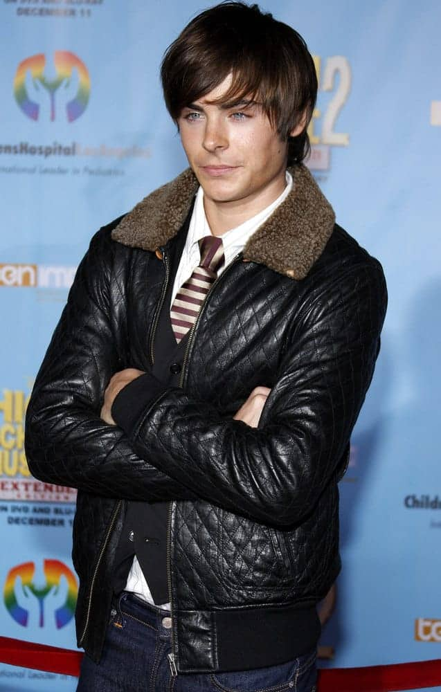 Zac Efron showed up with his signature look at the DVD Release premiere of