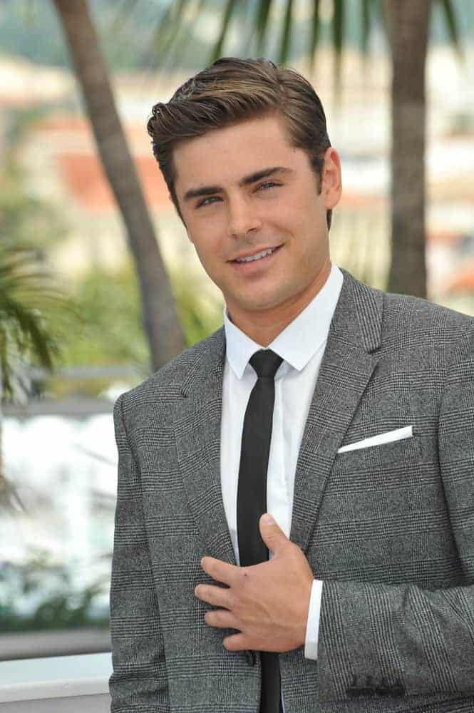 Zac Efron looked dashing with a brushed up frontal at the photocall for his movie