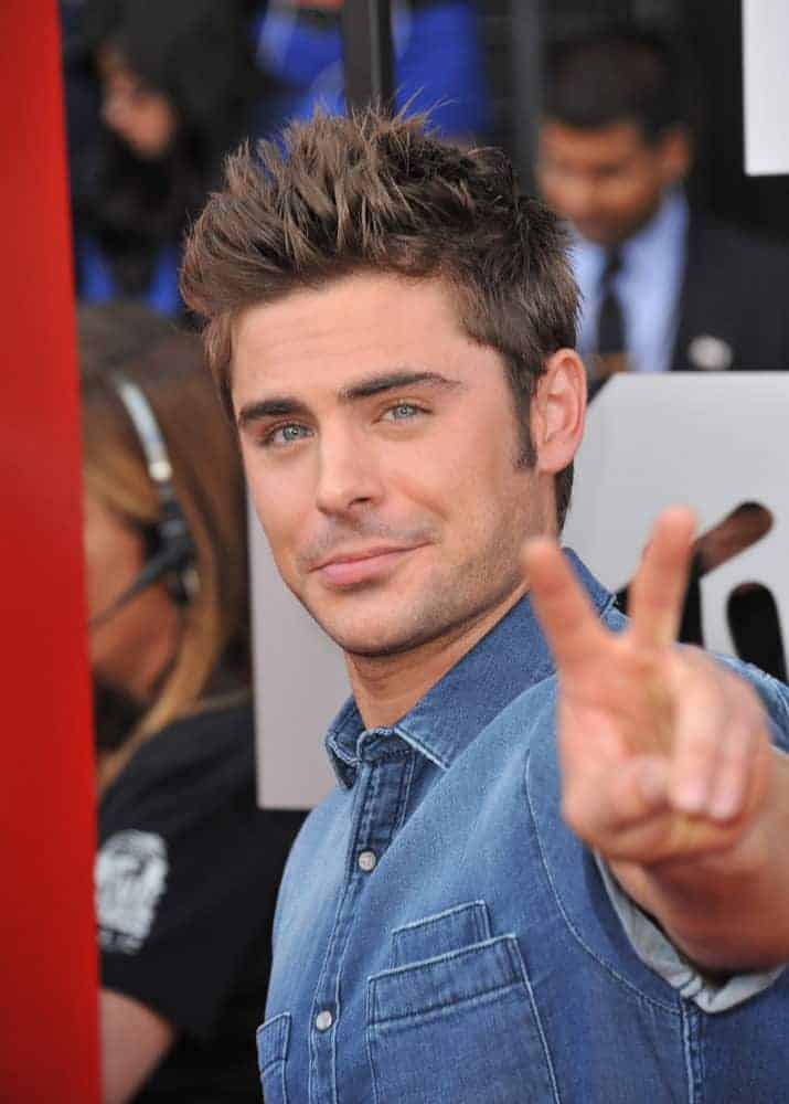 Zac Efron sported a boyband hairdo with short spiky hair during the 2014 MTV Movie Awards at the Nokia Theatre LA Live on April 13, 2014.