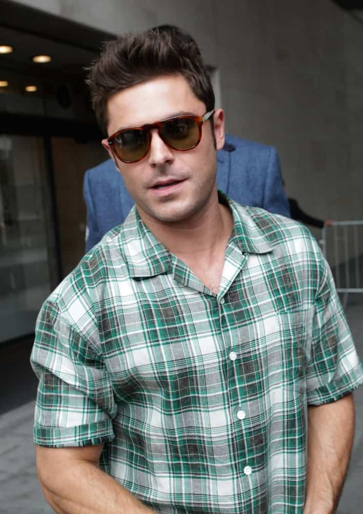 The actor was spotted at the BBC Radio One Studios at Broadcasting House on Aug 11, 2015 wearing a green plaid polo shirt along with a brushed up hairstyle.