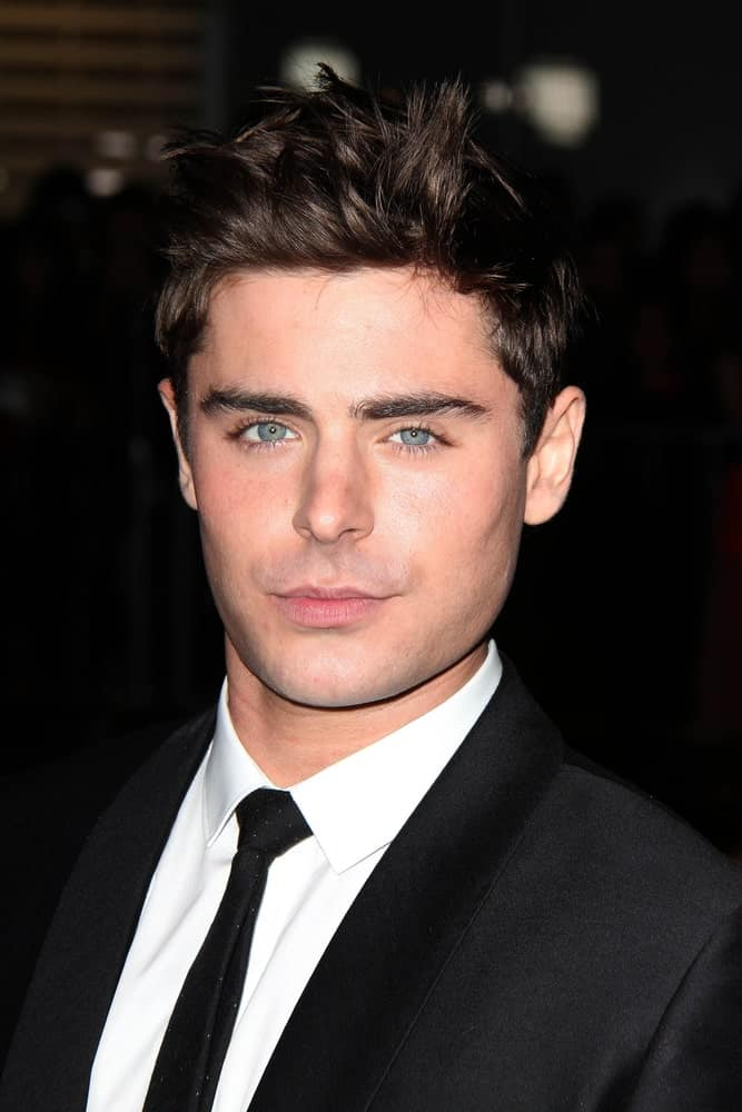 Zac Efron paired his classic black suit with brushed up spikes during the