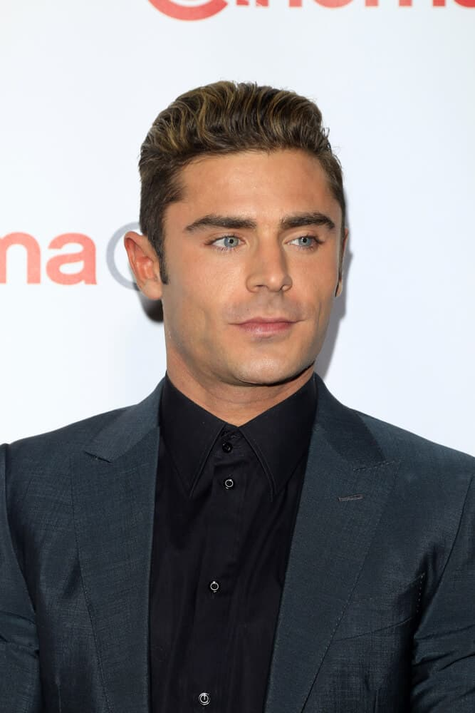 Zac Efron at the CinemaCon Awards Gala at the Caesars Palace on April 14, 2016 sporting his regular crew cut styled with highlighted brushed up hairdo.