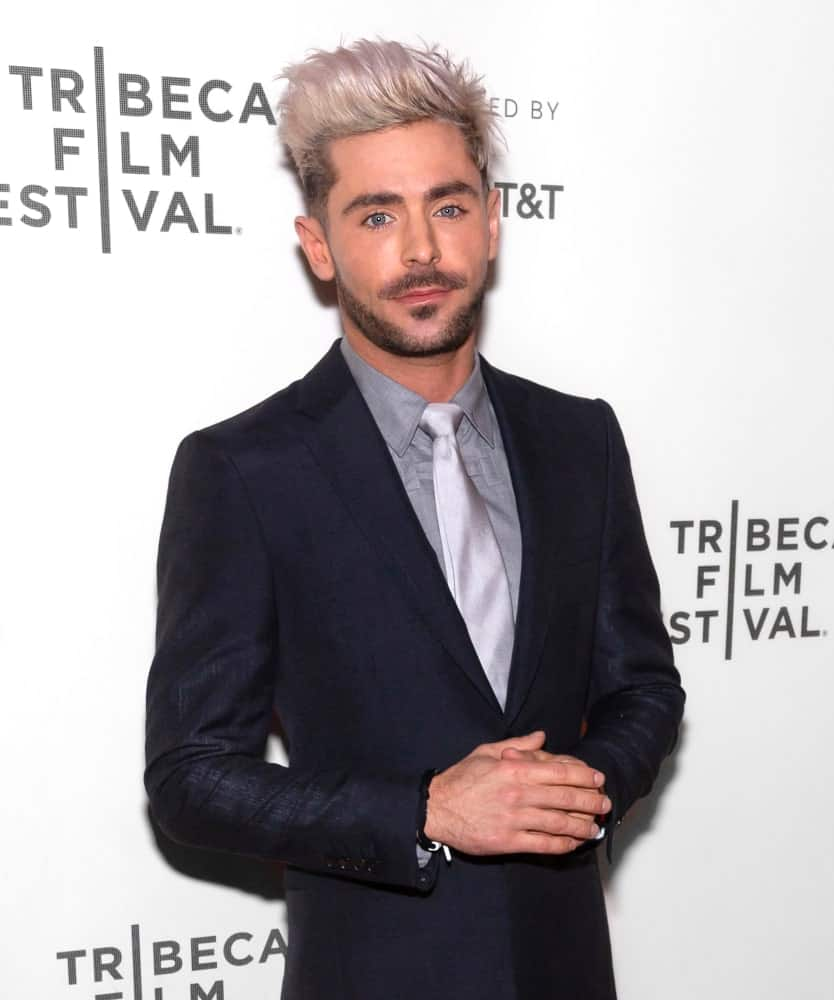 Zac Efron rocked a pompadour hairstyle with short sides nicely transitioned to his medium-length goatee at the premiere of Extremely Wicked, Shockingly Evil and Vile movie held on May 2, 2019.