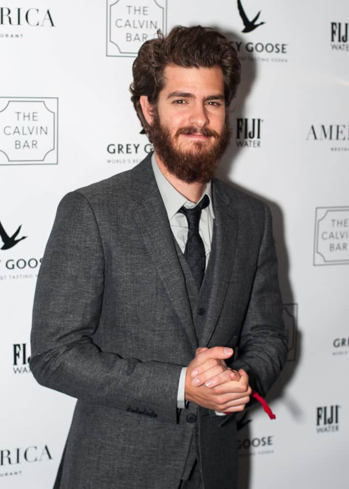 "Andrew Garfield went for a longer side-swept 'do with a heavy bearded look during the America Restaurant afterparty for the film ""99 Homes"" in 2014."