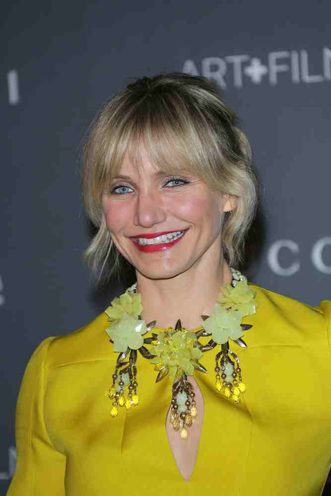Messy ponytail framed with wispy bangs never looked so cute and Cameron Diaz rocked this style at the LACMA 2012 Art + Film Gala on October 27, 2012.