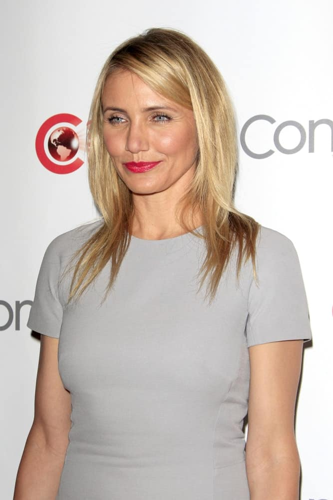 Cameron Diaz wore a simple medium length layers with a side part at the 20th Century Fox CinemaCon 2014 Photo Call on March 27, 2014.