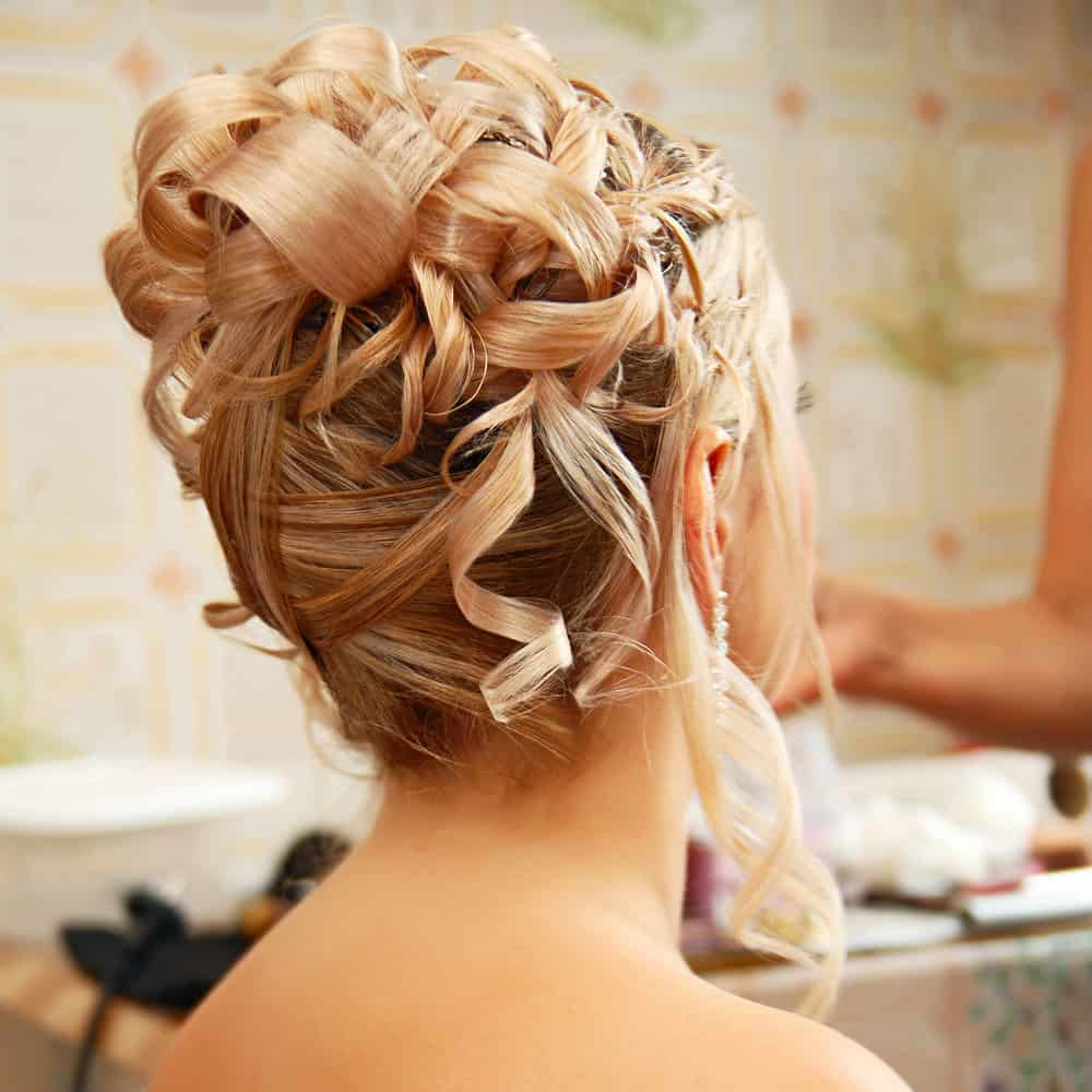 Curly updo wedding hairstyle.