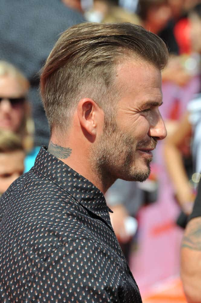 David Beckham shows the side profile of his tapered haircut at the first annual Nickelodeon Kids Choice Sports Awards at Pauley Pavilion, UCLA in 2014.