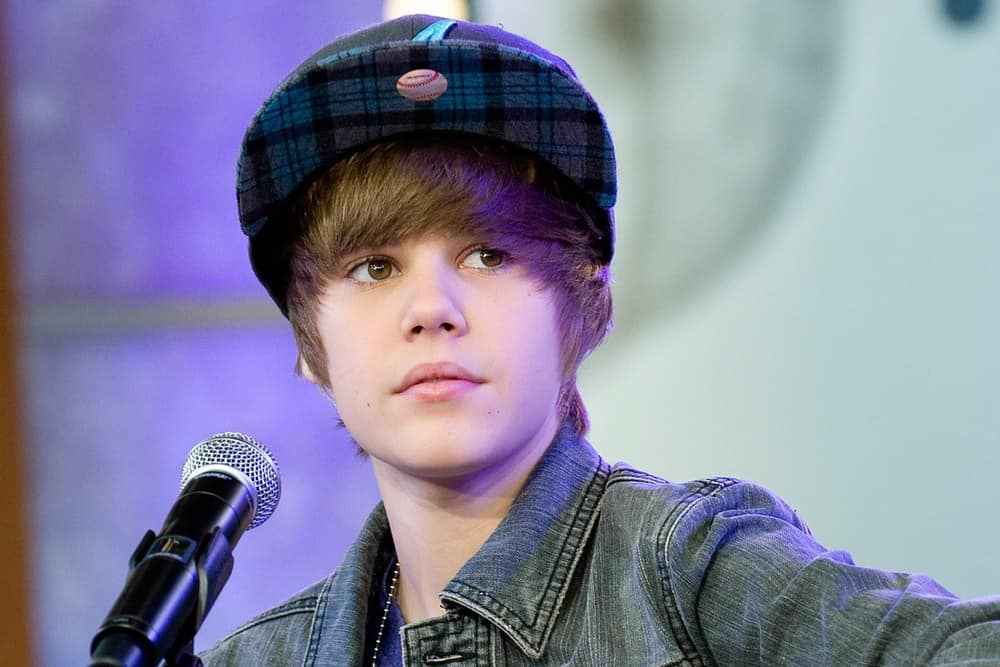 Young Justin Bieber popped into the music scene with this signature hairstyle and can be seen here performing for Good Morning America GMA Concert at the GMA Times Square Studio, New York, NY in 2009.