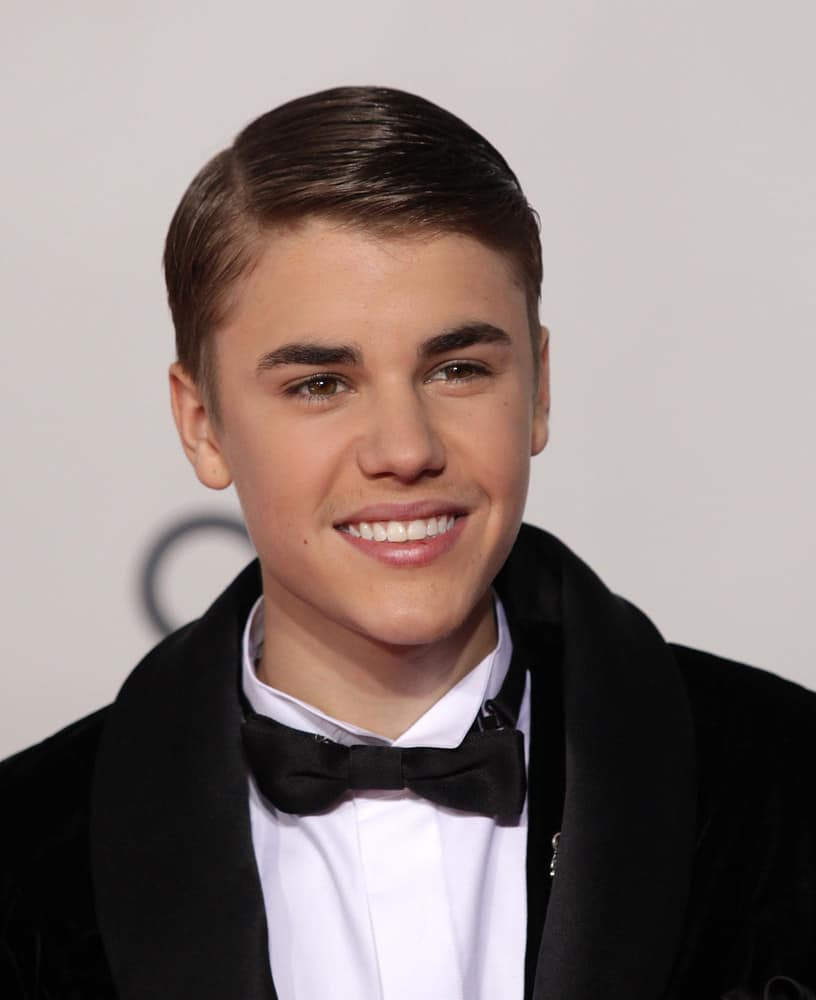 Justin Bieber gets gelled and went for a slicked down look at the American Music Awards 2011 in Los Angeles, CA.