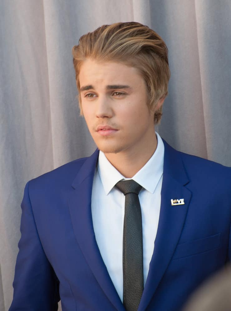 Justin Bieber Combs Back His Hair The Comedy Central Roast Of Justin Bieber  At Sony Studios
