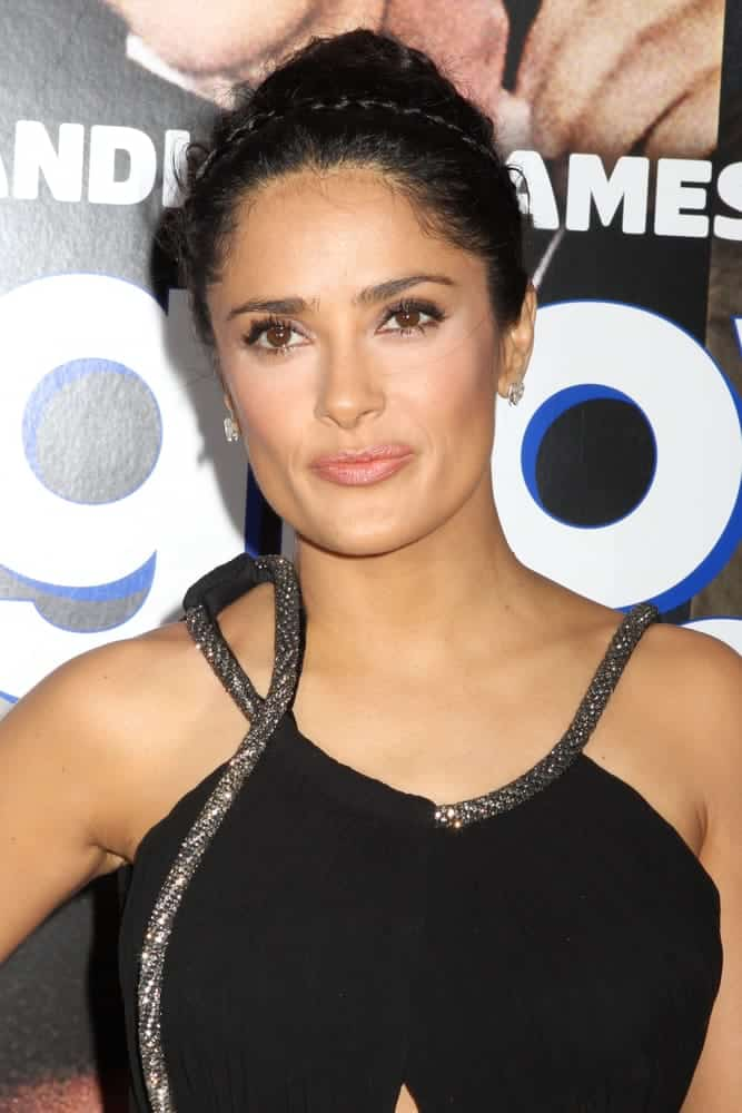 This is a tousled french twist up-do accented with a double crown-braid hairband, a classic style Salma Hayek wore at the premiere of