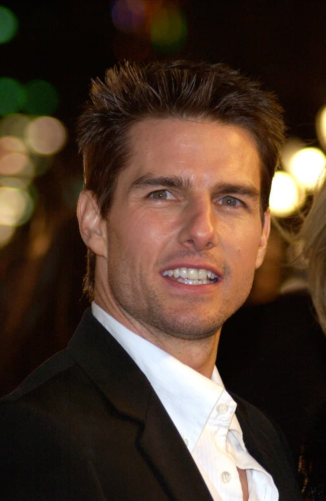 "Tom Cruise maintained his short cut hair but added some spikes at the front during the world premiere of his new movie ""Vanilla Sky"" in Hollywood in 2001."