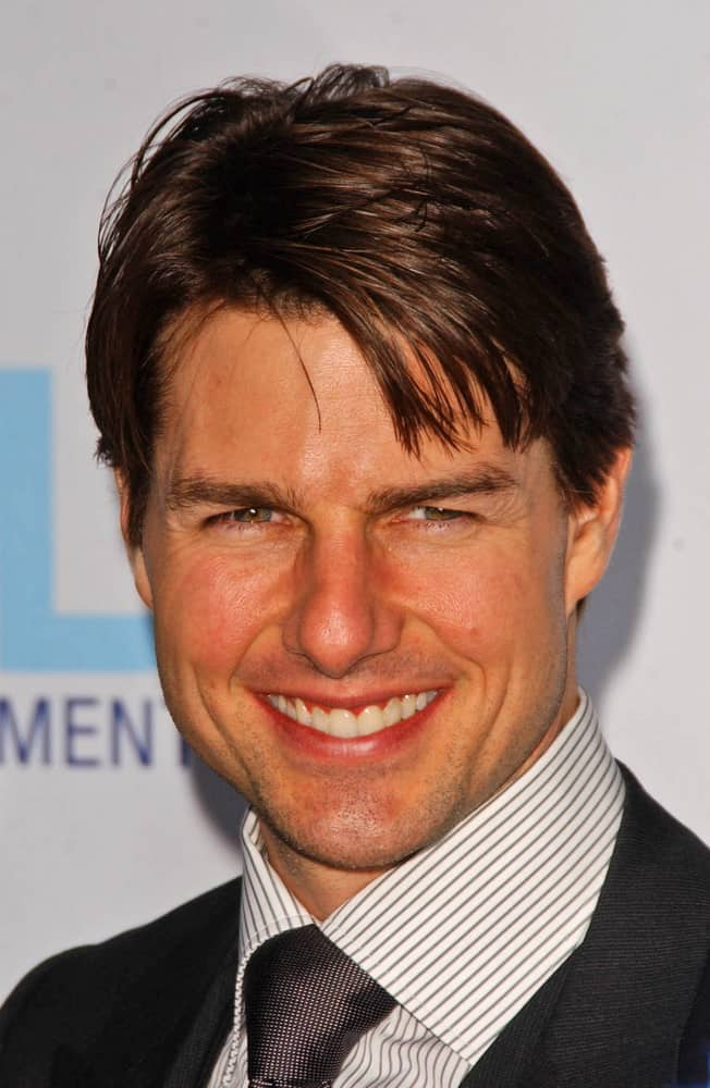 Tom Cruise opted for a taper cut sides and back with long wispy top hair at Mentor LA's Promise Gala in 2007.