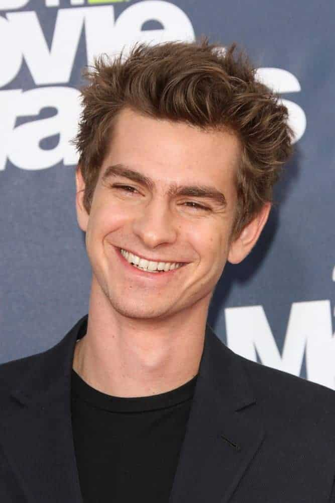 Andrew Garfield sported a tousled look combined with spikes for the 2011 MTV Movie Awards Arrivals at Gibson Amphitheatre, Universal City, CA.