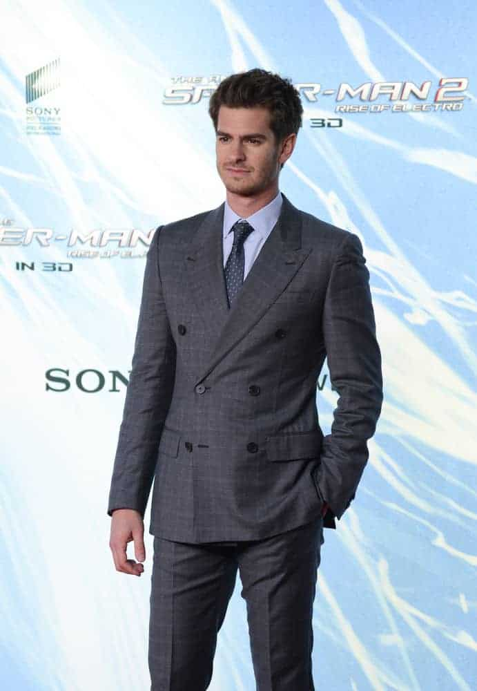 Andrew Garfield looked dapper in a suit along with short brushed up hair with subtle fade during