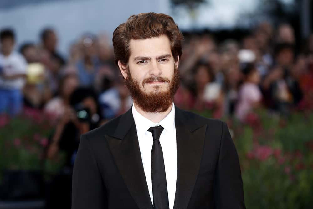 "Andrew Garfield paired his mussed up hairstyle with a bearded look when he attended the ""99 Homes"" premiere during the 71st Venice Film Festival on August 29, 2014 in Venice, Italy."