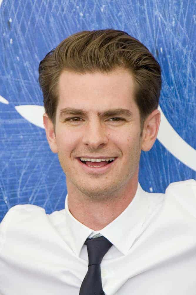 Andrew Garfield with his signature hairstyle while attending the photocall for 'Hacksaw Ridge' during the 73rd Venice Film Festival at Palazzo del Casino on in Venice, Italy.