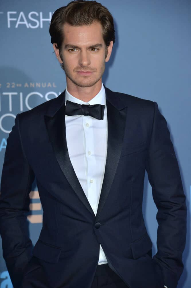 Andrew Garfield at the 22nd Annual Critics' Choice Awards at Barker Hangar, Santa Monica Airport on December 11, 2016 with his signature hairstyle on.